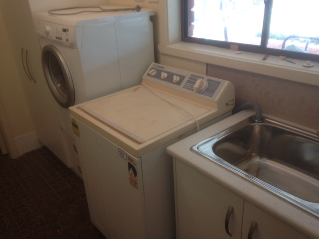 extra washing machine in laundry